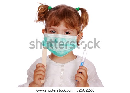 little girl doctor in mask with syringe - stock photo