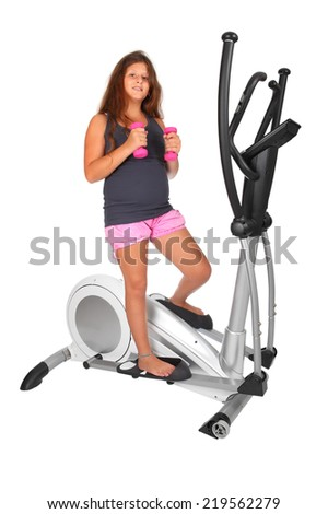 Little girl doing exercises with elliptical trainer, on white background