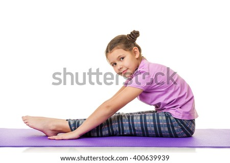 Little girl doing fitness exercises - stock photo