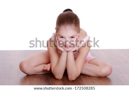 little girl doing gymnastic/young girl doing gymnastics over white background - stock photo