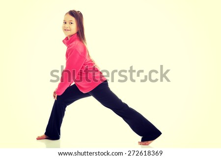Little girl doing gymnastics exercise - stock photo