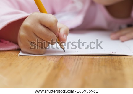 little girl doing her homework - stock photo
