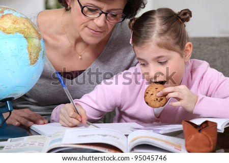 Little girl doing homework - stock photo