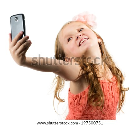 Little girl doing photo of her self over white background - stock photo