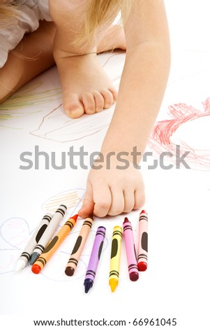 Little girl drawing. - stock photo