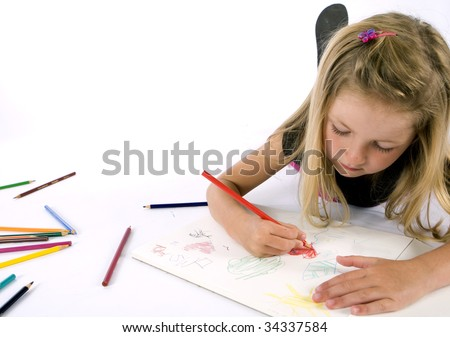 Little girl drawing on paper - stock photo