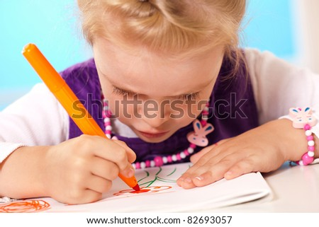 little girl drawing on paper the nature
