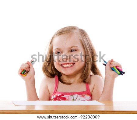 Little Girl drawing picture at table isolated on white - stock photo