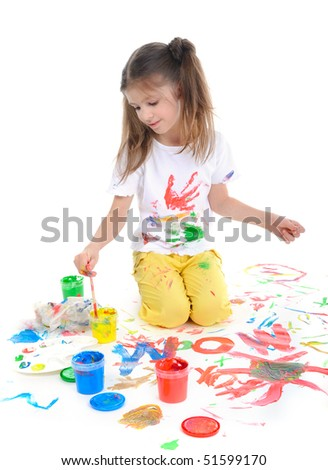 Little girl draws a colored paint sitting on the floor - stock photo