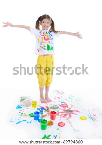 Little girl draws a paint. Isolated on white background - stock photo