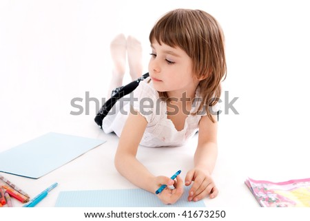 Little girl draws a picture. - stock photo