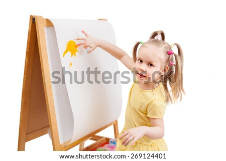 Little girl draws by painted colors on white paper.  - stock photo