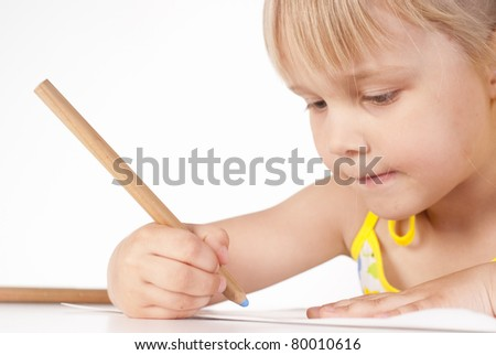 little girl draws on a white background - stock photo