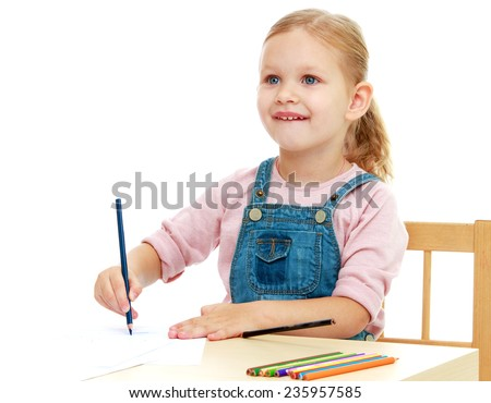 Little girl draws pencils sitting at the table.Childhood education development in the Montessori school concept. Isolated on white background.