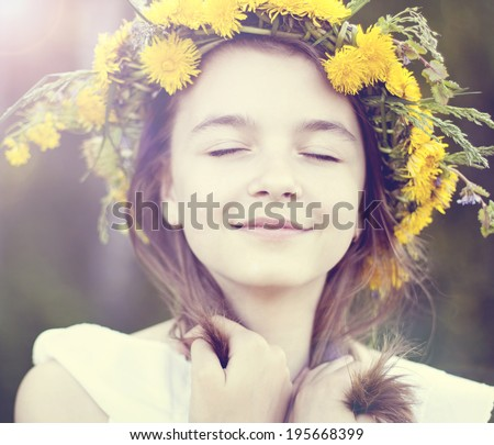 Little girl dreaming in the park - stock photo