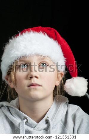 Little girl dreaming of christmas - stock photo