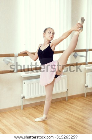 little girl dressed as a ballerina in ballet