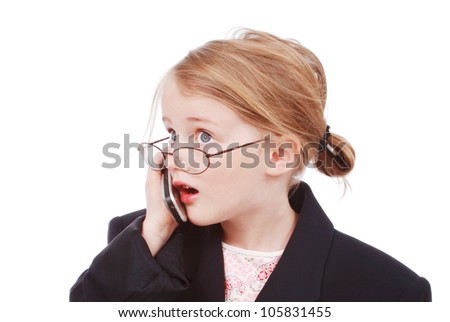 Little girl dressed as a businesswoman talking on a cell phone