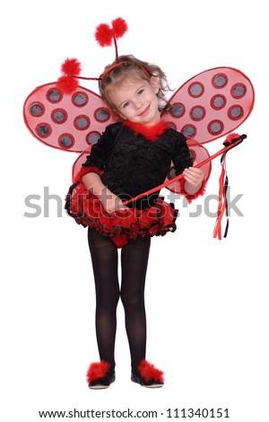 Little girl dressed as a ladybug - stock photo