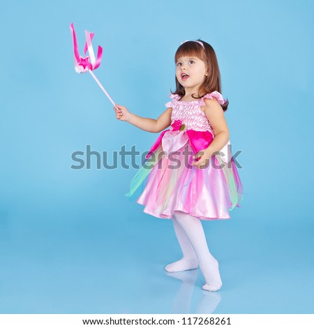 Little girl dressed as fairy with a magic wand - stock photo
