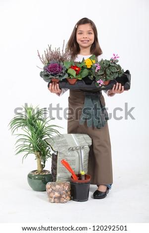 Little girl dressed as florist - stock photo