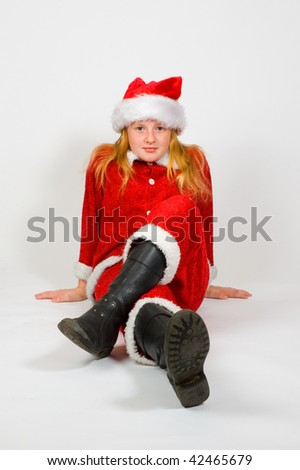 little girl dressed as santa on white
