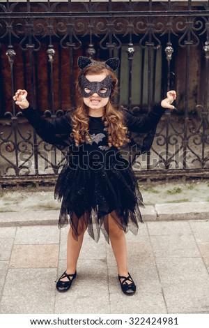 Little girl dressed in Halloween bat costume - stock photo
