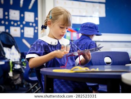 Little girl dressed in her school uniform  - stock photo