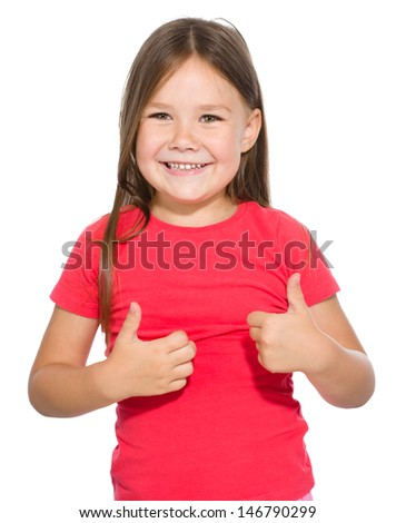 Little girl dressed in red is showing thumb up gesture using both hands, isolated over white - stock photo