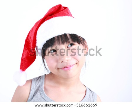 little girl dressed like a santa claus - stock photo