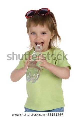 Little girl drink the water from plastic bottle - stock photo