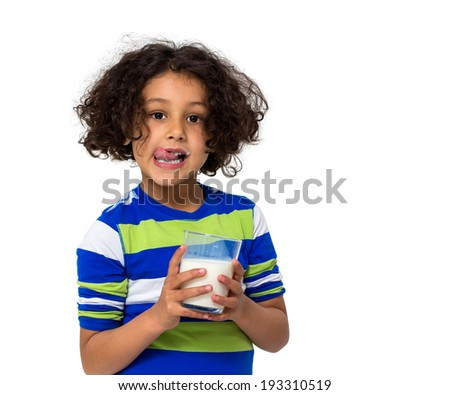 Little girl drinking a glass of milk isolated on white