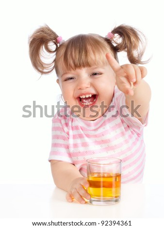 little girl drinking apple juice - stock photo