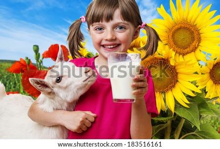 little girl drinking goat milk - stock photo