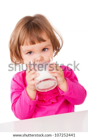 Little girl drinking milk, isolated on white - stock photo