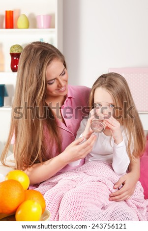 Little girl drinking water - stock photo