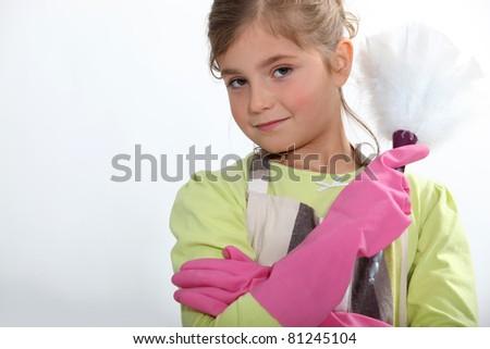 Little girl dusting - stock photo