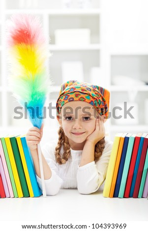 Little girl dusting her room - cleaning day in the kids room - stock photo