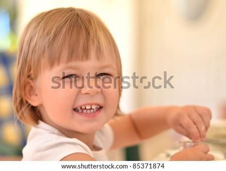 little girl eating - stock photo