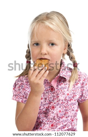 Little girl eating a biscuit. Isolated on white background
