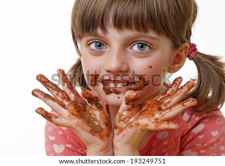 little girl eating a chocolate - stock photo