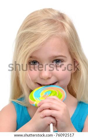 little girl eating a lollipop - stock photo