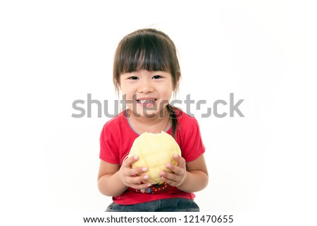 Little girl eating bread - stock photo