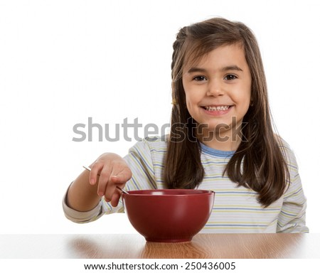 little girl eating breakfast out of marsala color bowl