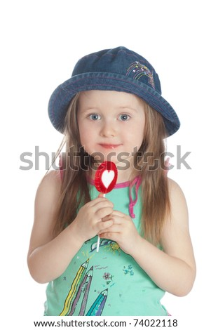 Little girl eating candy  lollipops on white background.