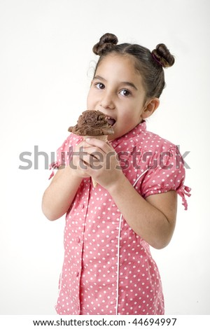 little girl eating choclate ice cream scoop in a cone isolated on white