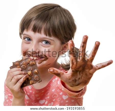 little girl eating chocolate - stock photo
