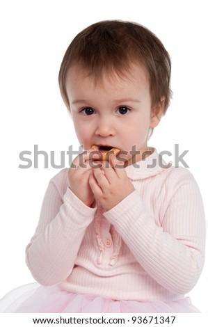 Little girl eating cookies isolated - stock photo