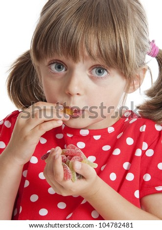 little girl eating gelatin candy - stock photo