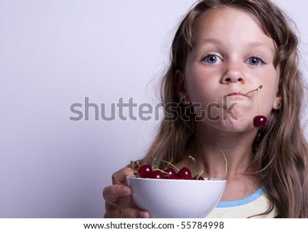 Little girl eating healthy food - stock photo